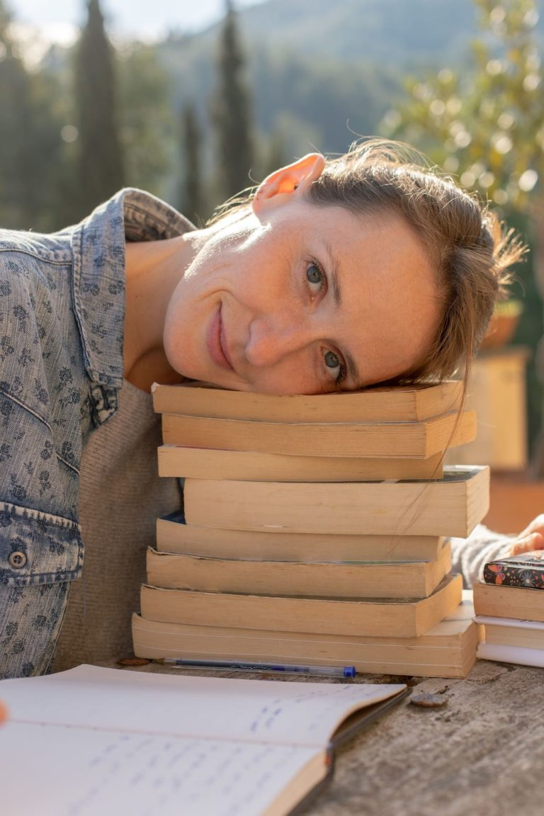 SEO writer with head on books